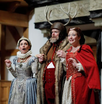 Falstaff wearing antlers with the two Merry Wives