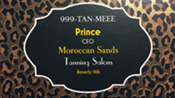 "Card with ""999-TAN-MEEE; Prince CEO Moroccan Sands Tanning Salons, Beverly Hills"" on a leopard print background"