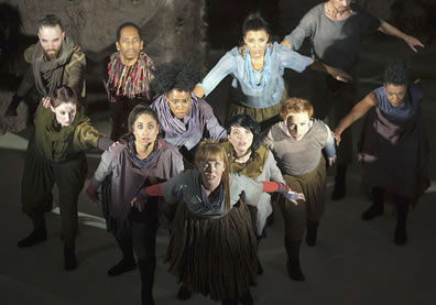 The whole cast, in a flying wedge, eyes upraised