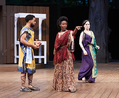 Production photo of Antipholus of Syracuse encountering Adriana and Luciana, who believe him to be the former's husband.