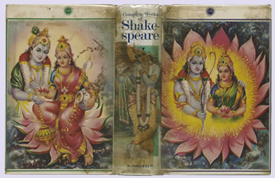 The full front, back, and spine cover, featuring a man and woman in traditional Indian garb amid a bright blooming yellow and pink flower