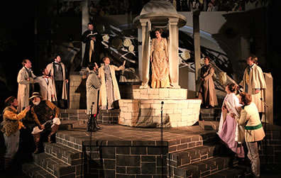 Production photo of the full set and the cast in the final scene, Hermione standing inside the cupolo center stage.