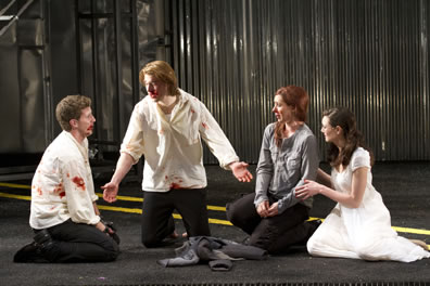 The two couples, bloodied, after the big brawl in the play's last scene