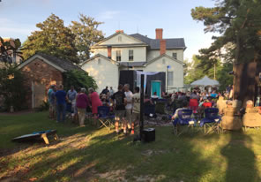 Photo of theater and crowd in Poe House backyard