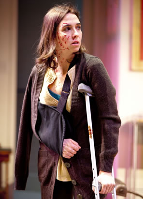Holly Twyford as Sarah on crutches, arm in sling, and bloody wounds on her face and neck