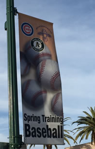Photo of streetlamp banner of Cubs and A's spring training