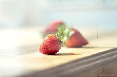 Strawberries on windowwsill in deep forcus